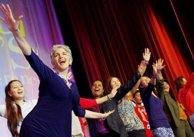 Deborah Torres Patel onstage with participants onstage EXCEL Women's Conference 2014